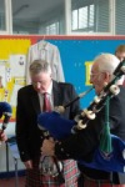 Pipe Major, Jim Dawson, tuning up Harry Norwood.