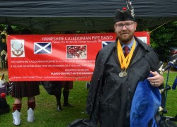 The Pipe Major with his winners medals.
