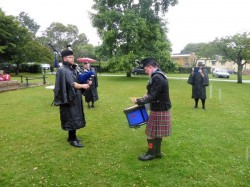 Pipe Major and Rory performing.